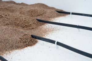 Sanden ger jämn värme och fungerar som värmebuffert.